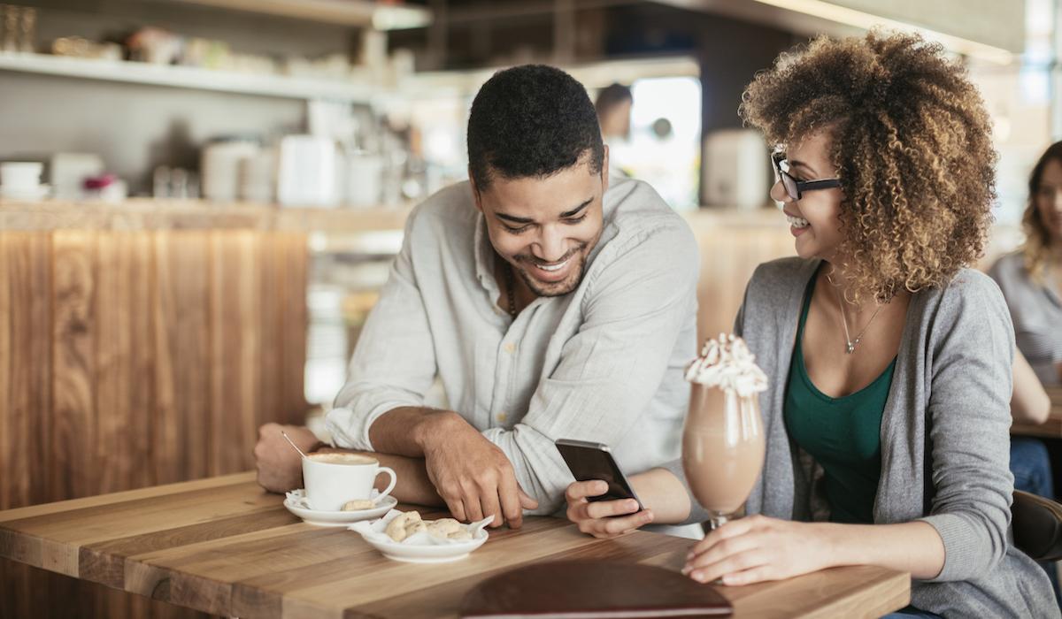 Happy couple in cafe enjoying coffee